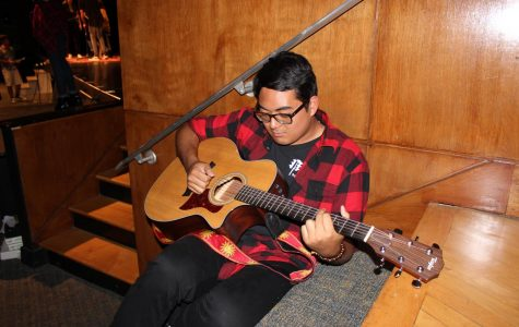 Strumming Away at Acoustic Night