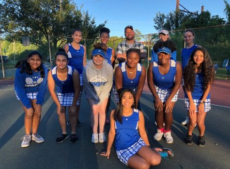 Girls' varsity tennis remain white division champions