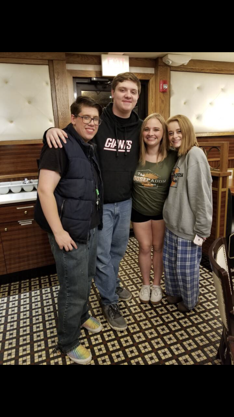 [Pictured: John Mendoza and Jodi Cesare with former club president and SWMHS graduate Patrick Smith and long-time club member Lindsay Ploskonka.]